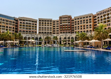 ABU DHABI, UNITED ARAB EMIRATES - SEPTEMBER 5, 2015: Swimming pool in 5 stars Hotel Ritz-Carlton Abu Dhabi, Grand Canal (532 rooms, gardens with private beach, pool, gym and 10 restaurants). - stock photo
