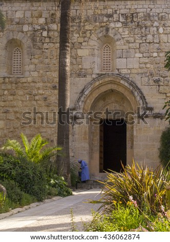 Abu Ghosh,Israel-April 29,2016:The nun Inside of Benedictine monastery in Abu Ghosh,built by the Crusaders in the 12th century on top of Roman ruins in the center of the village of Abu Ghosh, Israel.