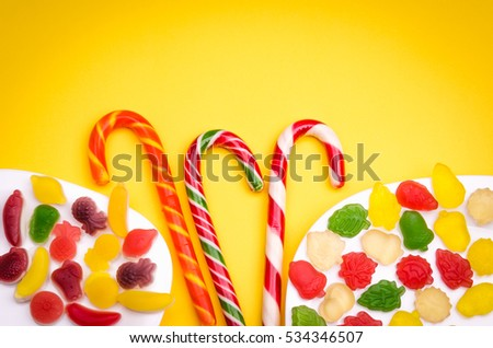 abundance of candies on a yellow background/abundance of candies