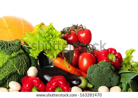 Abundance of different vegetables on white background - stock photo