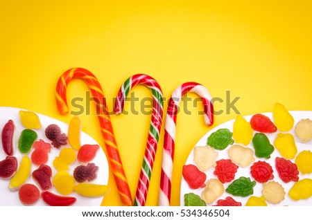 abundance of lollipops and fruit jelly/abundance of lollipops and fruit jelly on a yellow background