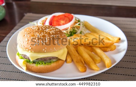abundant and tasty Hamburger with french fries ,soft focus. - stock photo