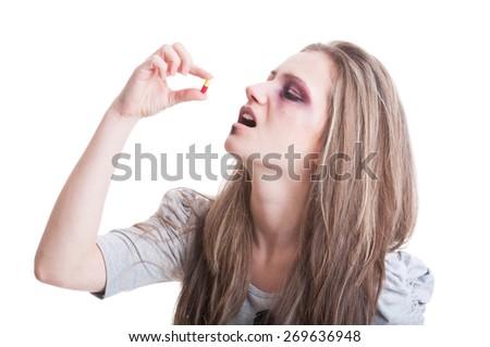 Abused, beaten and injured woman taking antibiotics isolated on white background - stock photo
