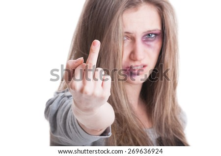 Abused woman victim of domestic violence raising middle finger to the camera or aggressor on white background - stock photo