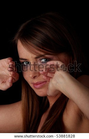 Abused young woman over black background