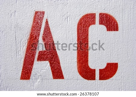 AC Stencil Letters in Red on White Painted Wood