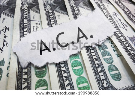 ACA - Affordable Care Act text on cash                                - stock photo