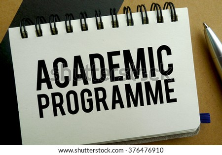 Academic programme memo written on a notebook with pen