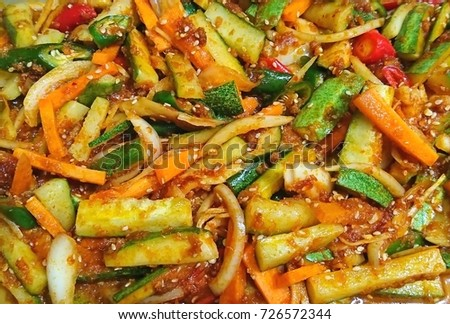 Acar is a kind of vegetable pickle served as condiment for any meals.