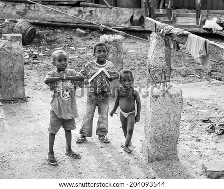 ACCARA, GHANA - MAR 2, 2012: Unidentified Ghanaian children stay in the street  in black and white. People of Ghana suffer of poverty due to the unstable economical situation