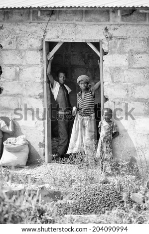 ACCARA, GHANA - MAR 2, 2012: Unidentified Ghanaian family near their house in black and white. People of Ghana suffer of poverty due to the unstable economical situation