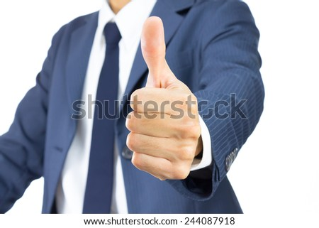 Accept or agreement or good concept for business design. Young Businessman in Blue Suit Show Thumb Up Isolated on White Background.