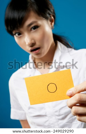 Accept pattern on yellow card hold by business woman on studio blue background. - stock photo