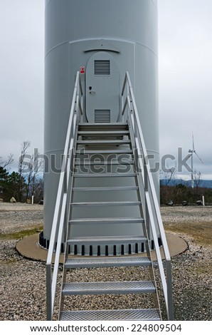 Access door to a wind tower located on the hills of Tuscany near Riparbella - stock photo
