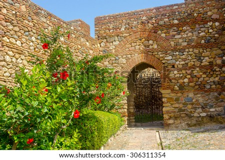 access of Arab style in the famous Palace of the Alcazaba in Malaga Spain - stock photo