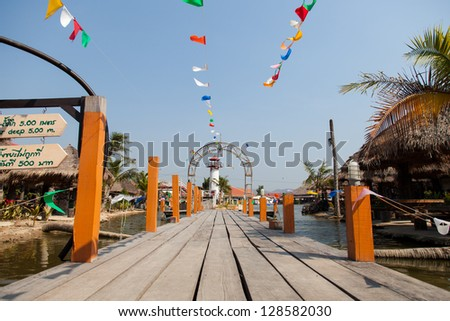 Access to the front of the wooden top with a colorful array of small flags - stock photo