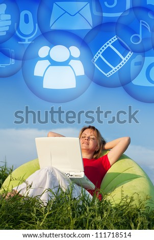 Access your data anywhere you are - cloud computing concept with woman on field - stock photo