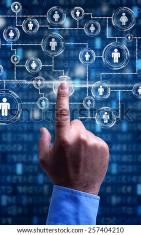 Accessing social media - businessman hand on futuristic screen - stock photo
