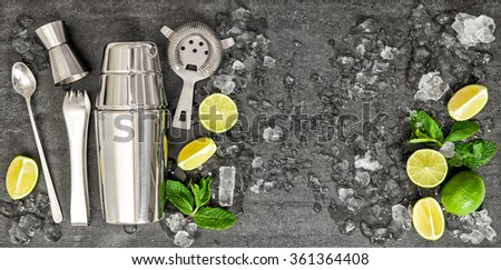 Accessories and ingredients for cocktail lime, mint, ice. Drink making. Top view - stock photo