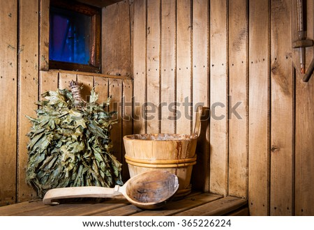 Accessories and interior of Finnish sauna. Wooden bucket with ladle - stock photo