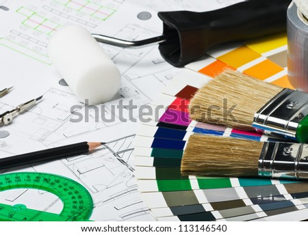 accessories and tools for home renovation are on architectural drawings - stock photo