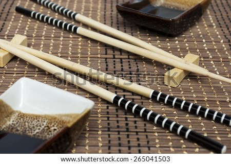 Accessories for dishes with rice,wooden sticks and bowls