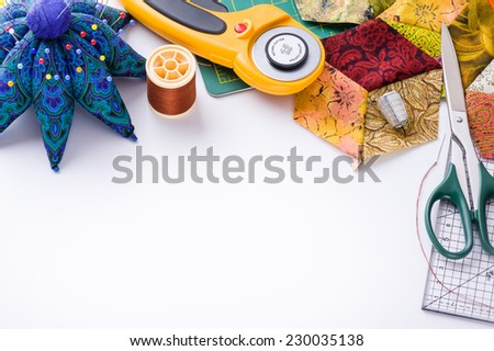 Accessories for patchwork top view on a white surface - stock photo