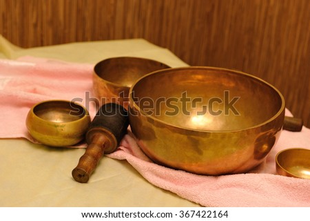 Accessories for sound massage. Tibetan singing bowls treatment - stock photo