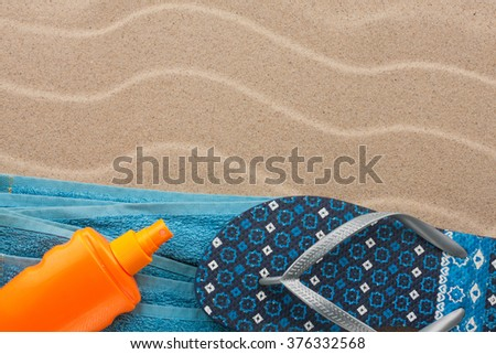 Accessories for the beach lying on the sand beach, with place for your text - stock photo