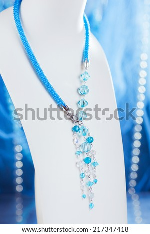 Accessories for the neck, beautiful handmade Colored buseny bracelet and necklace - stock photo