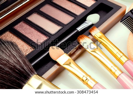 Accessories, makeup and mascara in close-up view.