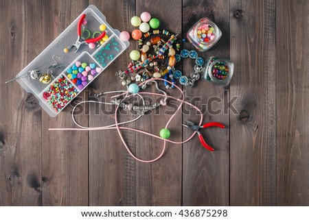 accessory for making home craft art jewellery layout on wooden table - stock photo