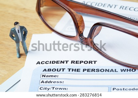 Accident report application form with businessman and eyeglass, insurance and risk concept; document is mock-up - stock photo