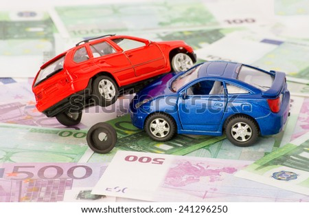 Accident two cars on a background of euro bills - stock photo