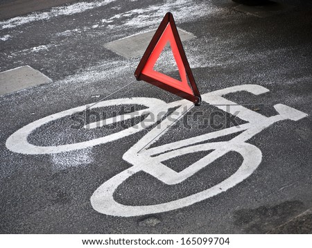 Accident warning sign on bycicle road, germany - stock photo