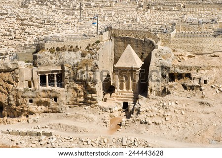 According to the bible this is the tomb of Zechariah the son of Jehoiada the priest, on the foot of the mount of olives in the Kidron Valley in Jerusalem. - stock photo