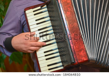 Accordion and fingers of a singer in a wedding special day - stock photo