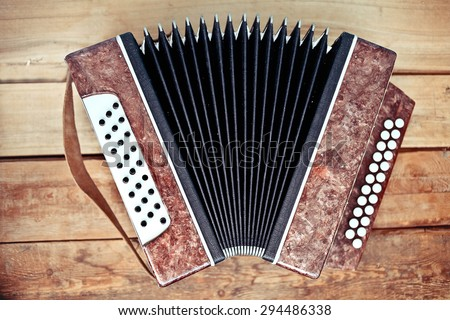 Accordion on wood background - stock photo