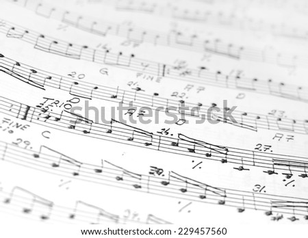 Accordion sheet music, abstract closeup background in black and white.  - stock photo