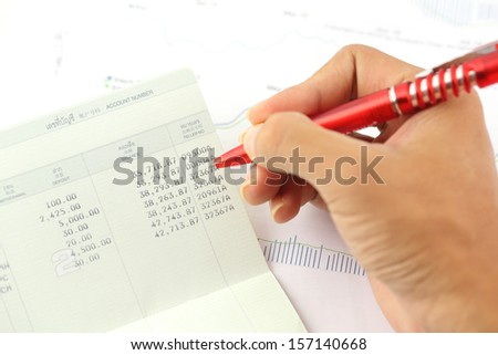Account book report with hand of someone