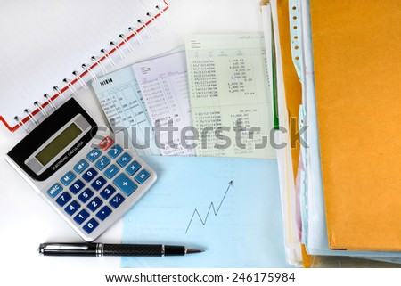 Account book with Calculator and documents. Finance and business graph - stock photo