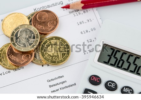 account statement and coins - stock photo