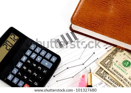Account statements, credit calculations, calculators, pen and dollar bills - stock photo