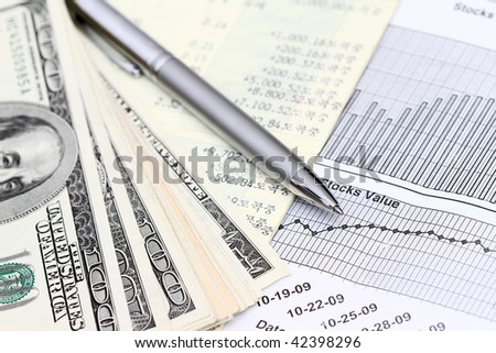 account statements with dollars and stocks graph.