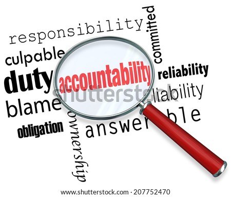 Accountability word under a magnifying glass looking for someone to take responsibility, credit or blame - stock photo