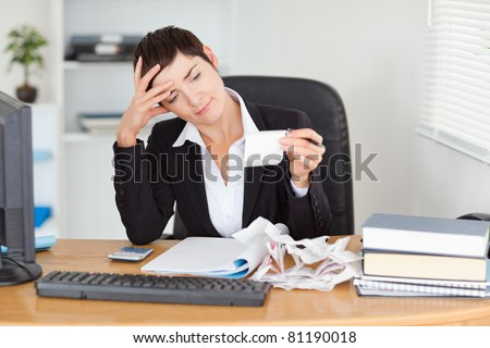 Accountant checking receipts in her office - stock photo