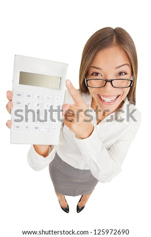 Accountant funny. Fun high angle perspective of an attractive gleeful woman or accountant in glasses pointing to a calculator that she is holding up with a blank digital readout isolated on white - stock photo