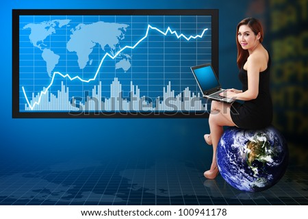 Accountant reporting the Graph on LCD monitor : Elements of this image furnished by NASA - stock photo