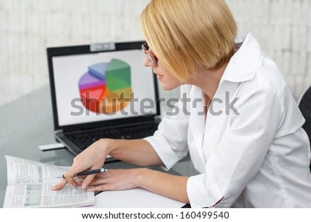 Accountant searching for laws, office - stock photo