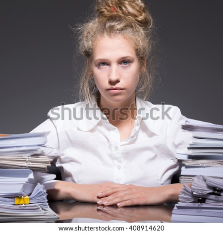 Accountant sitting at the desk at work - stock photo